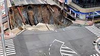 Huge Sinkhole Swallows Street In Fukuoka, Japan